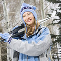 Female holding skis.