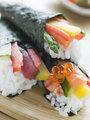 Three hand Rolled Seafood and Vegetable Sushi
