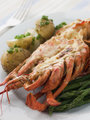 Half a Lobster Thermidor with New Potatoes and Asparagus Spears