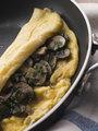Mushroom Omelette folded in a Omelette Pan