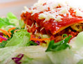 Close up of Lasagana with salad