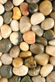 Colorful polished pebbles vertical view