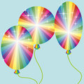 Three rainbow colored balloons