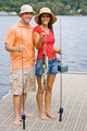 Couple fishing on pier