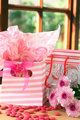 Two gift bags with pink candy around