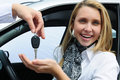 Happy woman receiving car key