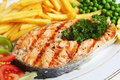 Grilled salmon steak with veg