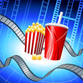 Popcorn and Soda on Film Strip Background