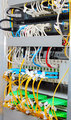 Fiber optic datacenter with media converters and optical cables 