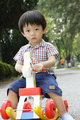 Boy riding toy horse