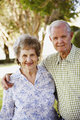 Elderly Couple Standing in Yard