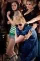 Blonde dancer in blue shirt