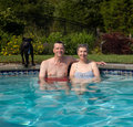 Couple in pool in yard
