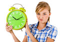 Girl giving funny expression and holding the alarm