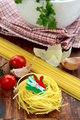 Different varieties of Italian pasta on a wooden board