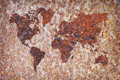 World map - corrosion stains on metal