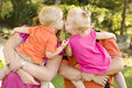 Mom and Dad Holding Kissing Brother and Sister Toddlers