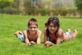 Smiling children on green grass