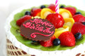 Birthday cake with mixed fruits on the top