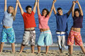 mixed race group of teens on summer vacation or spring break holiday