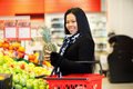 Asian Woman Buying Fruit
