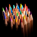 Top view of colored pencils, isolated on a black background