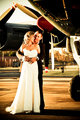 sexy young adult wedding couple standing with old war Albatross aircraft