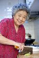 a grandmother is cooking in kitchen