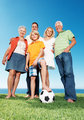 Happy family standing together with a football