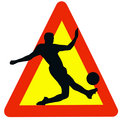 Soccer Player Silhouette on Traffic Warning Sign