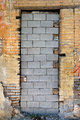 bricked up door and chipped brick wall texture