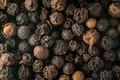 Macro photo of black peppercorn seeds