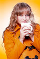 Woman in warm winter coat sipping hot coffee