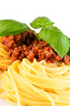 Spaghetti bolognese with leaf basil 