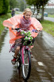 girl cycling in the rain