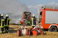 Burning round baler