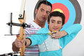 Teenage boy archery lesson