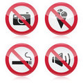 Forbidden sign: no cameras, no food, no smoking, no noise