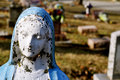Gravesite - Mary statue - background - close-up