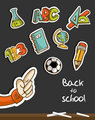 Back to School icons and hand on blackboard