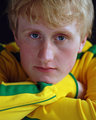 Close up pensive teenager in yellow