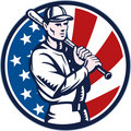 Baseball player holding bat with american stars and stripes flag