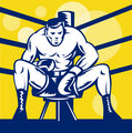 Boxer sitting on stool