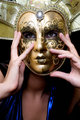 girl in a Venetian mask