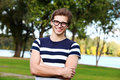 Portrait of young cute man with glasses in park
