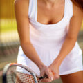 Close up of young tennis player ready for a serve