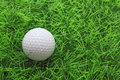 closeup of golf ball on green grass