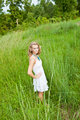 Woman in Tall Green Grass