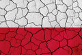 Flag of Poland over cracked background