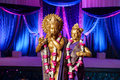 Hindu Deities in front of mandap at Indian wedding